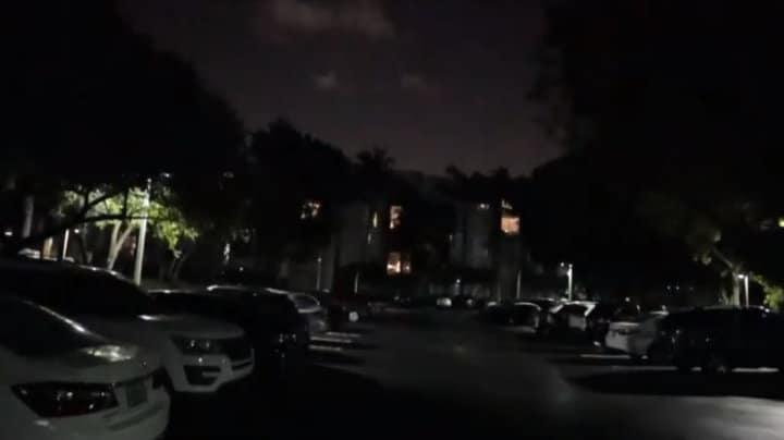 Canon camera on a dark parking lot